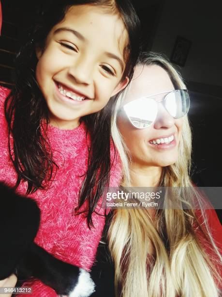 Portrait Of Happy Girl With Mother