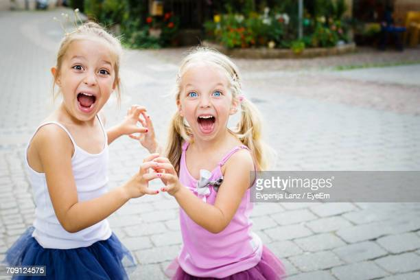 portrait of happy girls playing - eccitazione foto e immagini stock
