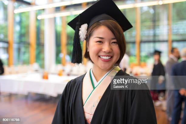 Portrait of happy graduate at graduation ceremony