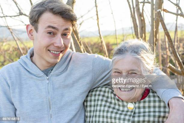 Portrait Of Happy Grandmother With Grandson Against Trees