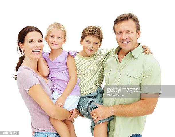 Portrait of happy husband and wife holding son and daughter