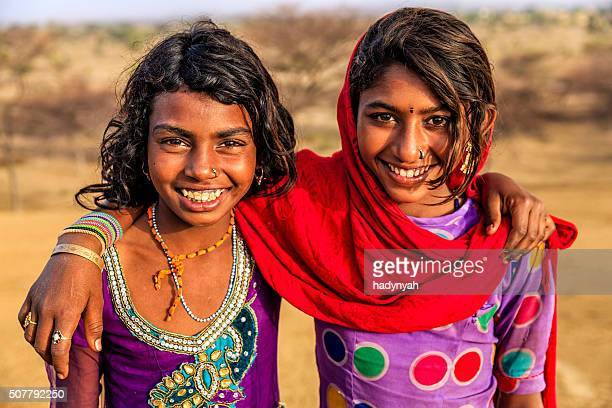 Portrait of happy Indian girls in desert village, India