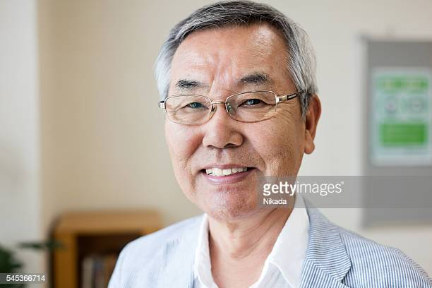 Portrait of happy japanese senior man in hospital