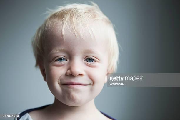 Portrait of happy little blond boy