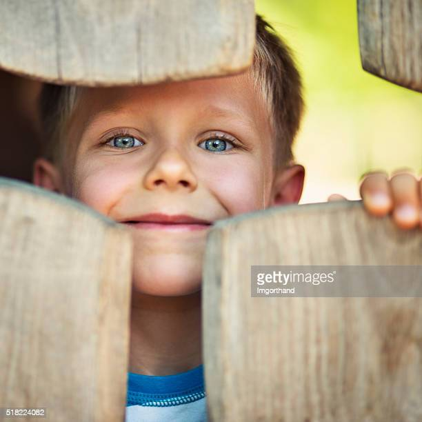 Portrait of happy little boy in the playground