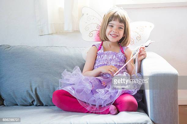 Portrait of happy little girl dressed up as fairy queen