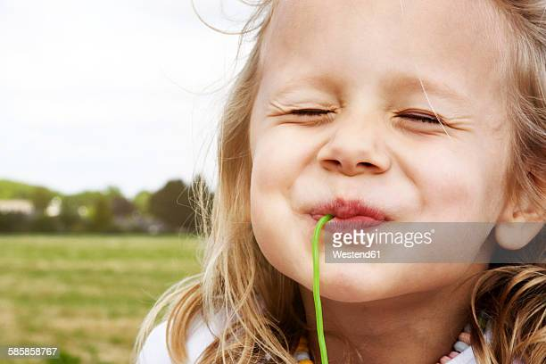 Portrait of happy little girl eating sweets