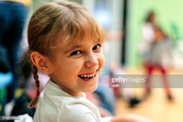 Portrait of Happy Little Girl in kindergarten