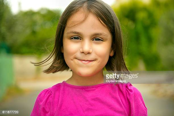 Portrait of happy little girl looking at camera