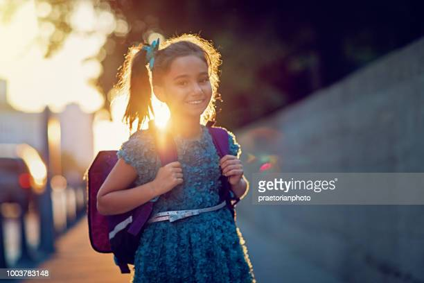 portrait of happy, little girl returning from school - first day of school stock pictures, royalty-free photos & images