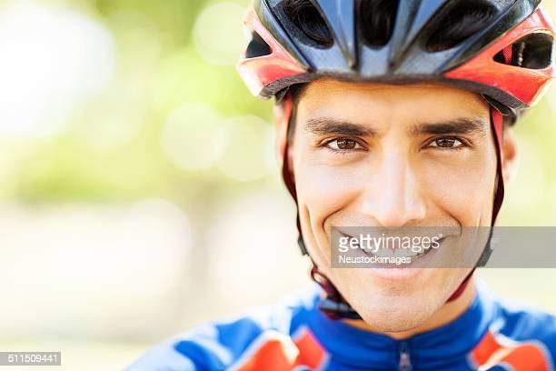 Portrait Of Happy Male Cyclist Wearing Helmet