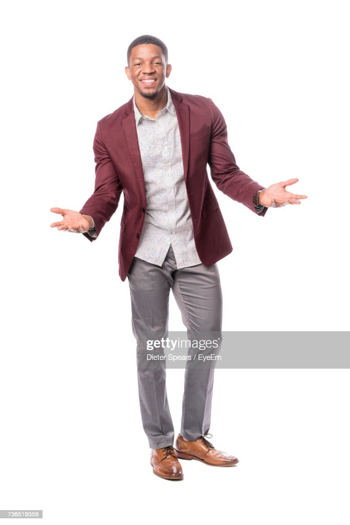 Portrait Of Happy Male Model Gesturing While Standing Against White Background : Stock Photo