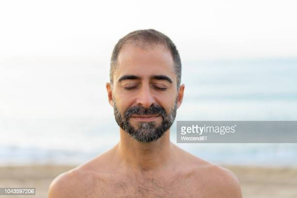 portrait of happy man on a beach in the evening - eyes closed stock pictures, royalty-free photos & images