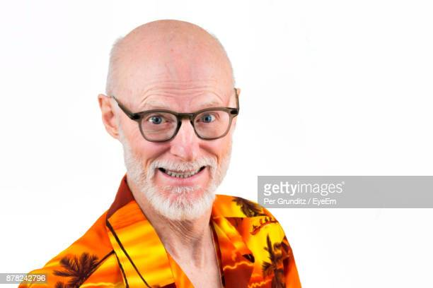 Portrait Of Happy Man Wearing Eyeglasses Against White Background