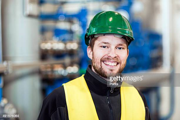 Portrait of happy manual worker at industry