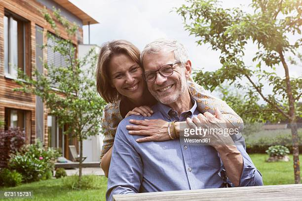 Portrait of happy mature couple in garden