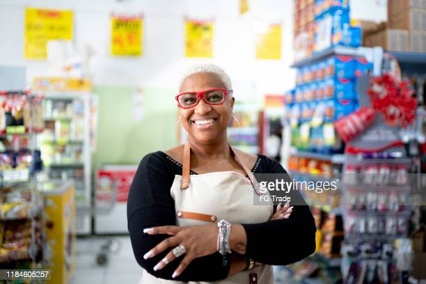 portrait of happy mature employee at wholesale - convenience store stock pictures, royalty-free photos & images