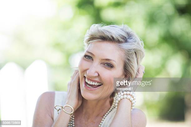 Portrait of happy mature woman outdoors