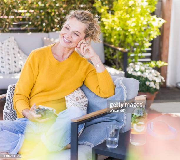 portrait of happy mature woman relaxing on terrace - beautiful people stock pictures, royalty-free photos & images