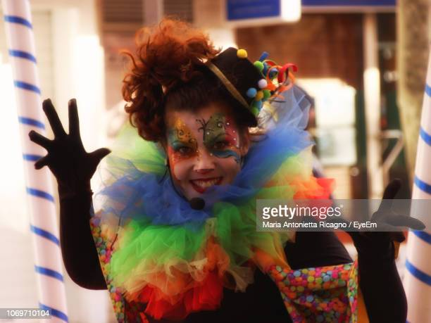 Portrait Of Happy Mid Adult Woman In Face Paint Standing Outdoors