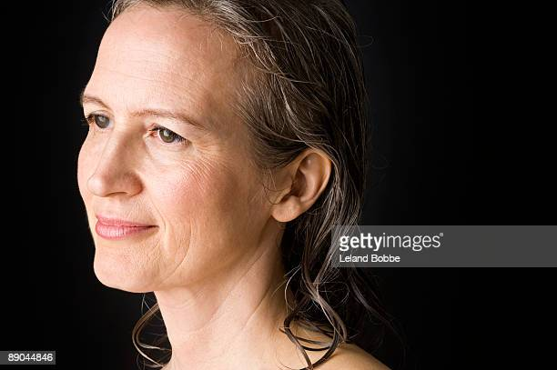 portrait of happy mid-aged woman with wet hair hor