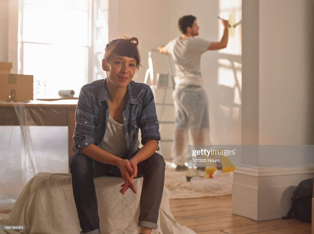 Portrait of happy mixed race woman in her new home : Stock Photo