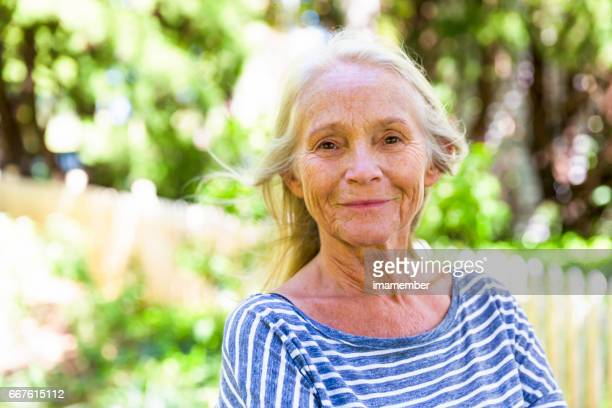 Portrait of happy, modern, attractive mature woman in sunshine