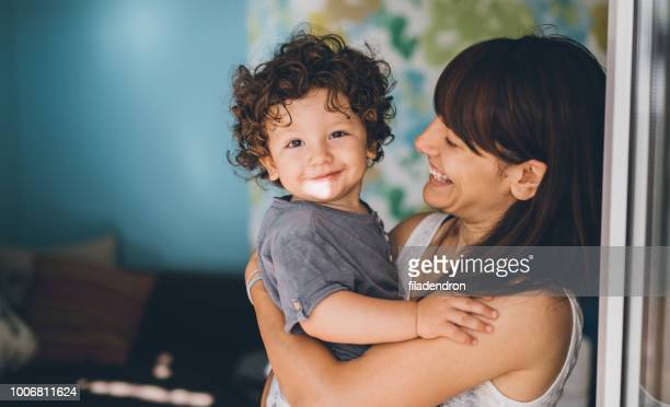 portrait of happy mother and son - baby boys stock pictures, royalty-free photos & images