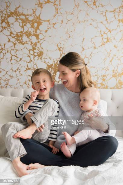 Portrait of happy mother of two children (18-23 months, 4-5)