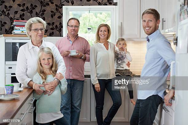 Portrait of happy multi-generation family in kitchen