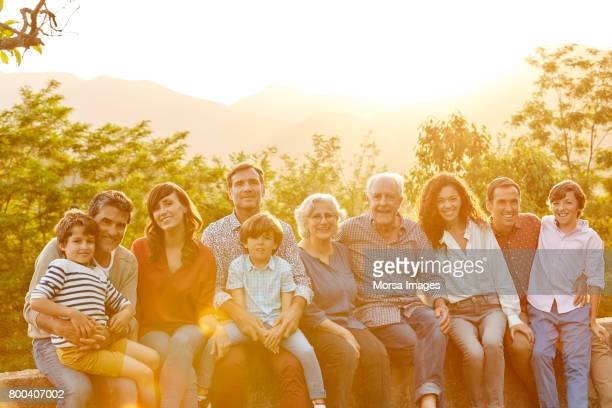 portrait of happy multi-generation family in yard - side by side stock photos and pictures