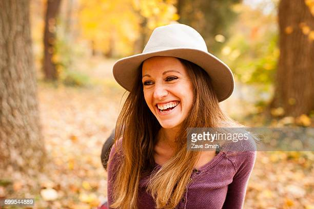 portrait of happy of young woman in autumn forest - fedora stock pictures, royalty-free photos & images