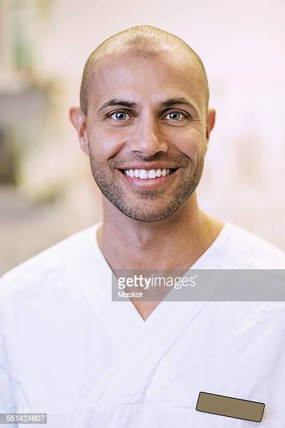 Portrait of happy orthopedic doctor in clinic