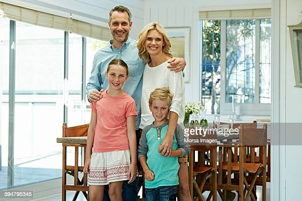 Portrait of happy parents with children at home