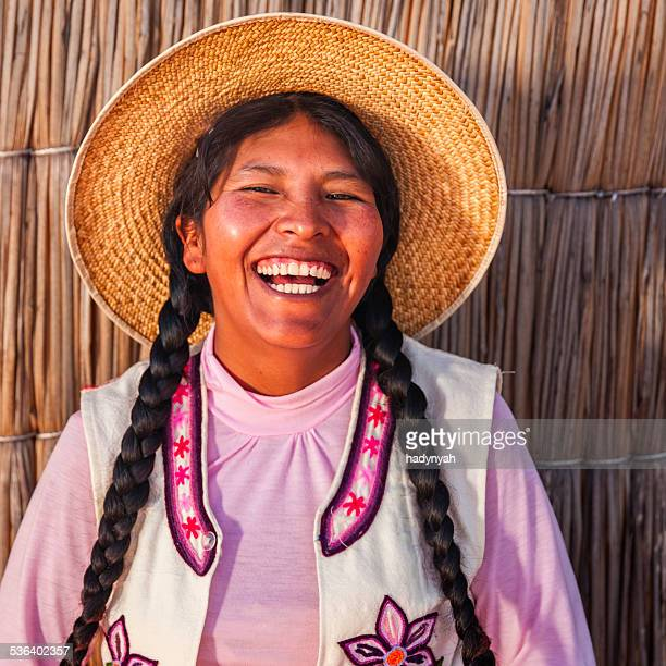 portrait of happy peruvian woman, uros floating island, lake tititcaca - bolivia stockfoto's en -beelden