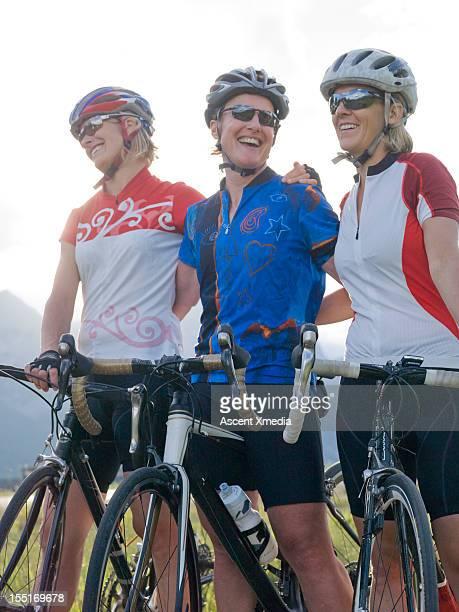 Portrait of happy road riding ladies, in mtns