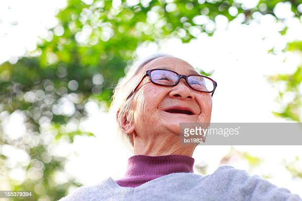 portrait of happy senior asian woman in the garden