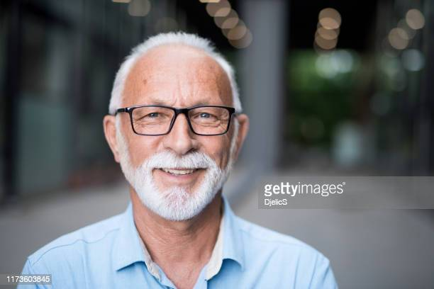 portrait of happy senior businessman. - mature men stock pictures, royalty-free photos & images