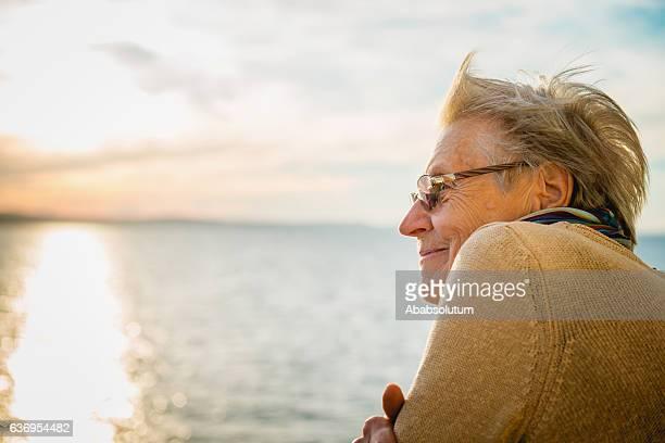 portrait of happy senior caucasian woman on ferry, croatia, europe - ferry photos et images de collection