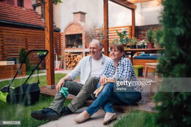 Portrait of happy senior couple enjoying in the backyard