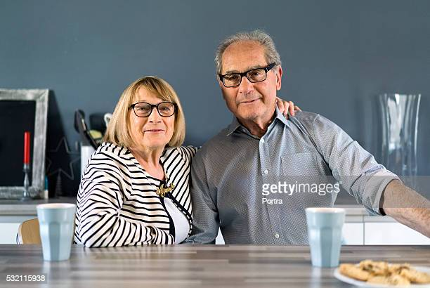 Portrait of happy senior couple sitting at table