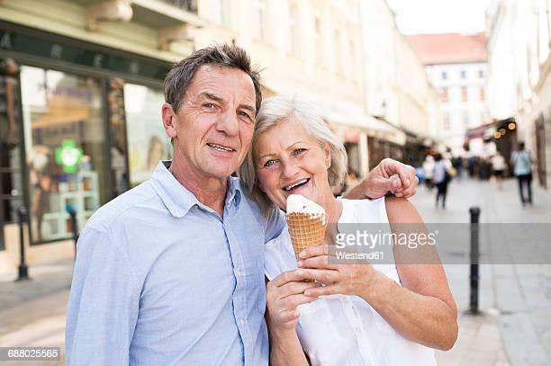 Portrait of happy senior couple with ice cream cone