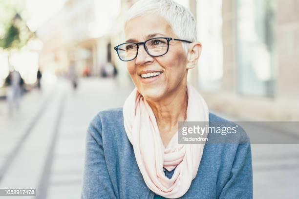 portrait of happy senior lady - high society stock pictures, royalty-free photos & images