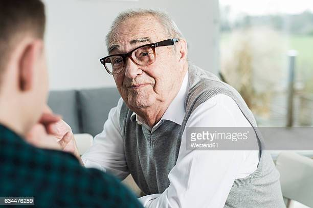 Portrait of happy senior man communicating with his grandson