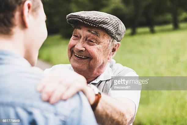Portrait of happy senior man with his grandson