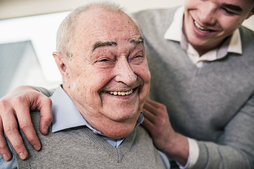 Portrait of happy senior man with young man - gettyimageskorea