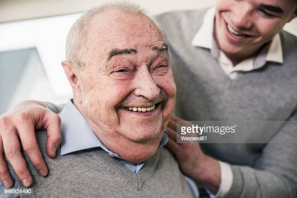 Portrait of happy senior man with young man