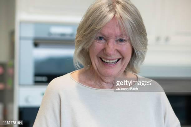 portrait of happy senior woman at home - cultura británica fotografías e imágenes de stock
