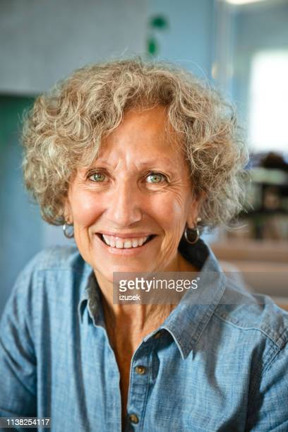 portrait of happy senior woman at nursing home - hazel eyes stock pictures, royalty-free photos & images