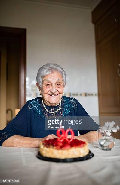Portrait of happy senior woman celebrating her ninetieth birthday